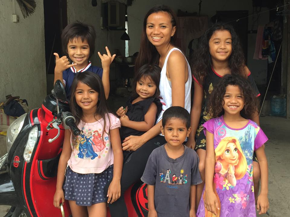 Rania, center, in Timor with her nieces and nephews